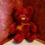 Peluche Nounours rouge (ruban orange)